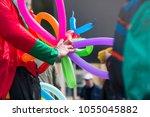 a freelance clown creating... | Shutterstock . vector #1055045882