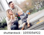 parents and boy look happy and... | Shutterstock . vector #1055056922