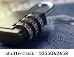 padlock on computer motherboard.... | Shutterstock . vector #1055062658