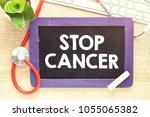 stop cancer text on blackboard  ... | Shutterstock . vector #1055065382