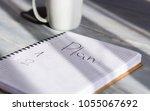 plan written in a notebook in... | Shutterstock . vector #1055067692