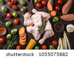 top view of raw chicken pieces... | Shutterstock . vector #1055075882