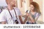 happy tourists walking around... | Shutterstock . vector #1055086568