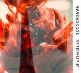 Small photo of Red ink in the water. Abstract blurred background for design.