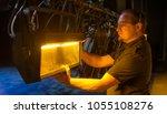 theater lighting technician... | Shutterstock . vector #1055108276