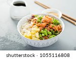 poke bowl with raw salmon  rice ... | Shutterstock . vector #1055116808
