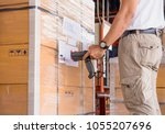 warehouse manager holding... | Shutterstock . vector #1055207696
