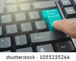 finger pressing green build... | Shutterstock . vector #1055235266