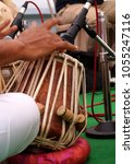 Small photo of Playing tabla,membranophone percussion instrument or pair of drums from Indian subcontinent, used in traditional, classical, popular and folk music