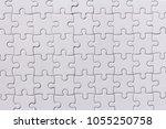 background white jigsaw | Shutterstock . vector #1055250758