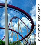 Small photo of Kings Island, Ohio / USA - July 27, 2016 - Riders at Kings Island enjoy the suspense as they head to the top of the 215 foot tall drop on Diamondback, a B&M roller coaster.