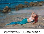 mermaid girl with red hair and... | Shutterstock . vector #1055258555