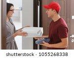 young woman receiving order... | Shutterstock . vector #1055268338