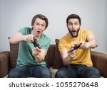 two young friends playing...   Shutterstock . vector #1055270648