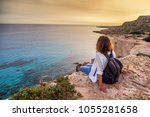 a stylish young woman traveler... | Shutterstock . vector #1055281658