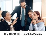 young family decides who will... | Shutterstock . vector #1055292212
