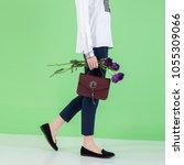 model holds fashion handbag on...   Shutterstock . vector #1055309066