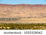 windmills that generate... | Shutterstock . vector #1055328062