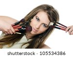 The beautiful girl with brushes for make-up - stock photo