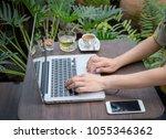 asian woman using labtop at... | Shutterstock . vector #1055346362
