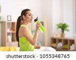 beautiful young woman drinking... | Shutterstock . vector #1055348765