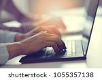 hands with laptop typing in...   Shutterstock . vector #1055357138