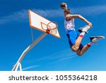 young basketball street player... | Shutterstock . vector #1055364218
