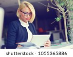 businesswoman in office working ... | Shutterstock . vector #1055365886