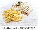 beef tacos served with golden... | Shutterstock . vector #1055388902