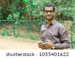 indian young man with his...   Shutterstock . vector #1055401622