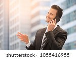 happy businessman in suit and... | Shutterstock . vector #1055416955