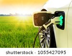ev car or electric car at... | Shutterstock . vector #1055427095