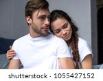 young man and woman tenderly... | Shutterstock . vector #1055427152