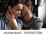 bearded man embracing...   Shutterstock . vector #1055427206