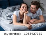 brunette woman lying by her... | Shutterstock . vector #1055427392