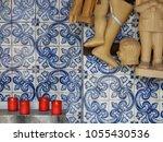 red firing candles and wax...   Shutterstock . vector #1055430536