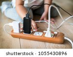 toddler playing with plug | Shutterstock . vector #1055430896