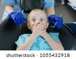 so scared. pleasant little girl ... | Shutterstock . vector #1055432918