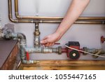 man working at pipes. employee... | Shutterstock . vector #1055447165