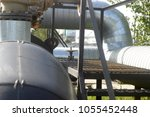 thick heating pipes on the... | Shutterstock . vector #1055452448