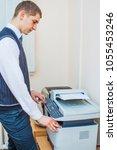 copier start  finger pressing...   Shutterstock . vector #1055453246