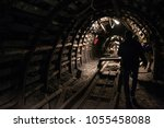 underground black coal mine... | Shutterstock . vector #1055458088