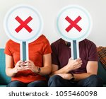 couple showing no symbol sign | Shutterstock . vector #1055460098