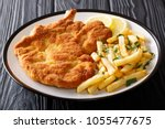 fried veal cutlet milanese with ... | Shutterstock . vector #1055477675