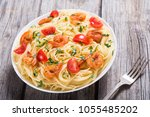 pasta . spaghetti with shrimps  ... | Shutterstock . vector #1055485202