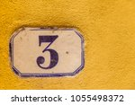 numbered tile on a wall | Shutterstock . vector #1055498372
