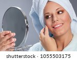 beautiful spa woman holding... | Shutterstock . vector #1055503175