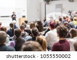 female speaker giving... | Shutterstock . vector #1055550002