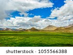 green wheat and yellow rape...   Shutterstock . vector #1055566388