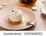 mini mousse  cake covered with... | Shutterstock . vector #1055568932